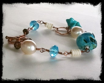 Turquoise Crystal, Pearl, Shell, Czech Glass and Magnesite Skull Bracelet