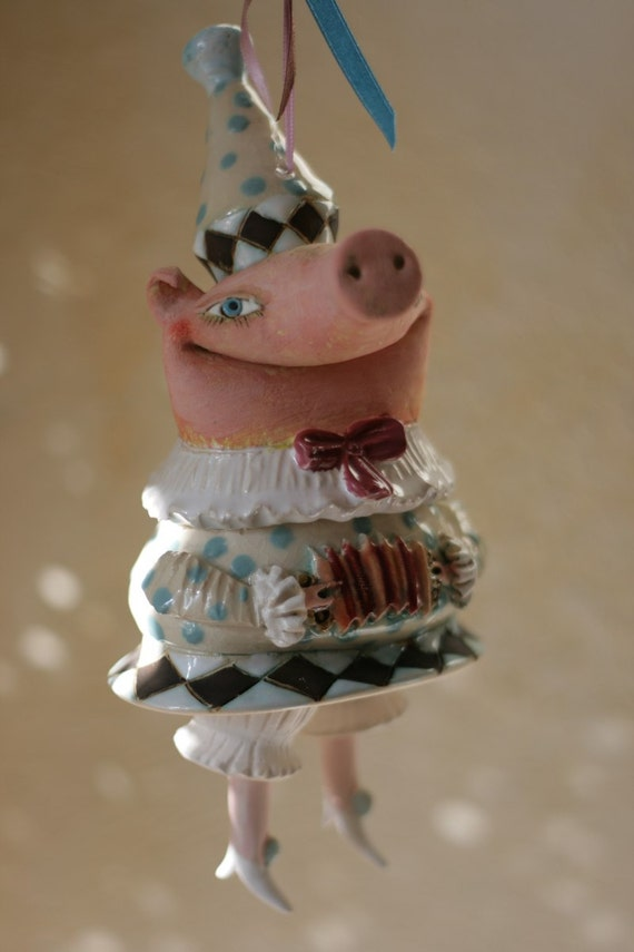 Piglets song. Funny cute bell-doll, little ceramic sculpture. Happy pig.
