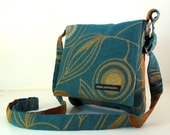 "Hip Bag in teal and gold ""Deco"" fabric. Adjustable strap. Cross Body Bag. Washable. Black ballistic nylon lining. Made in America."