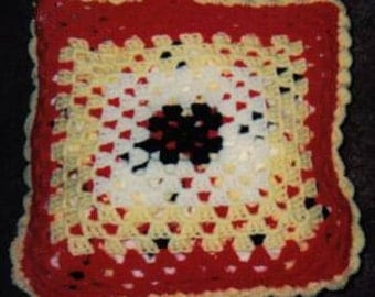 Pattern for crocheted-black-red- yellow and white- quillo afghan