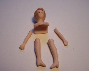 One ceramic doll