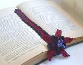columbine bookmark crocheted in black, burgundy and purple thread,