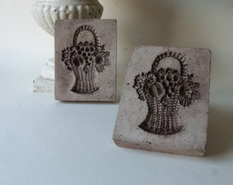 two cement fruit basket tiles