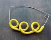 Brooch design in yellow silk crochet