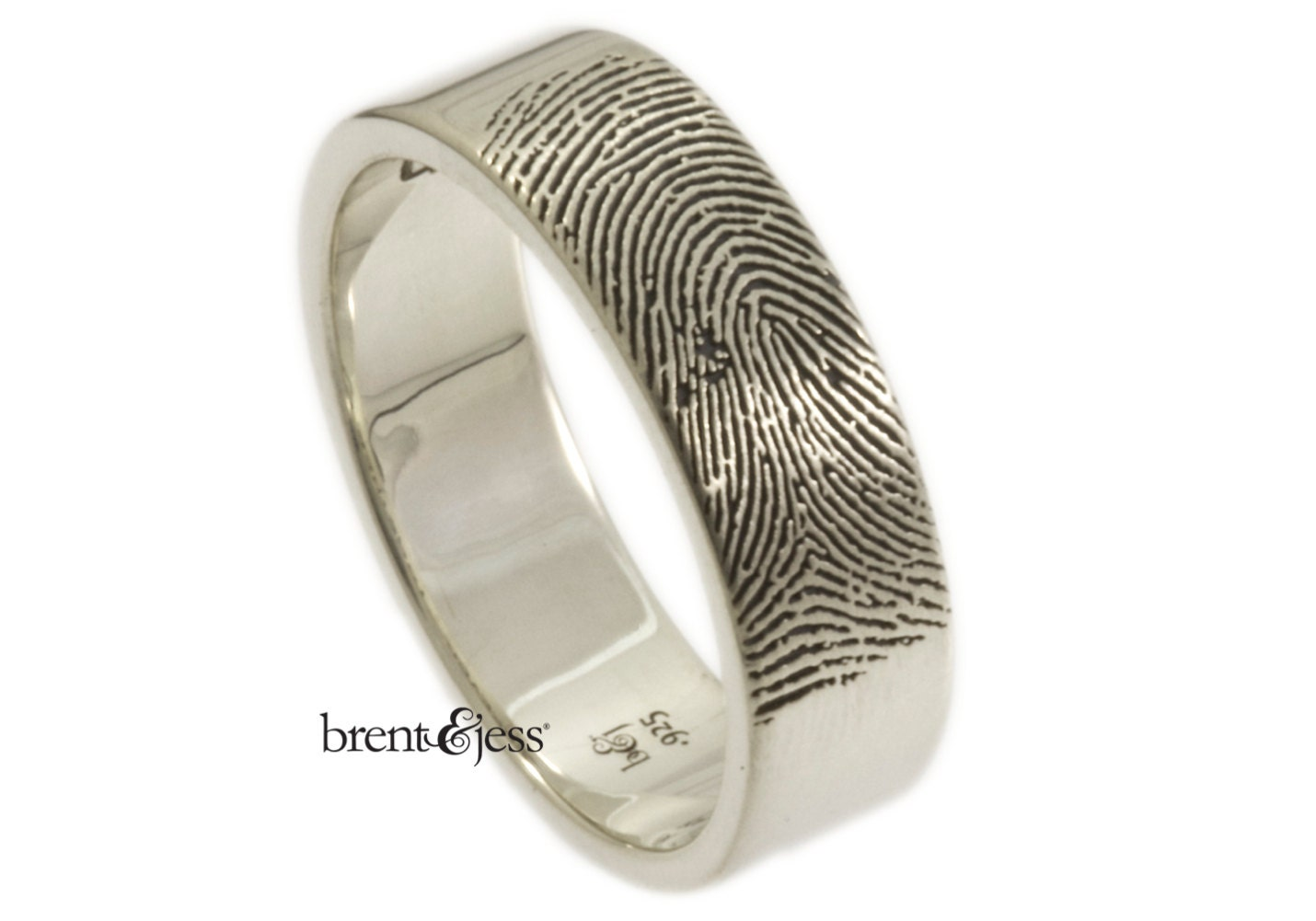 wide mens fingerprint wedding ring with a finger tip print on