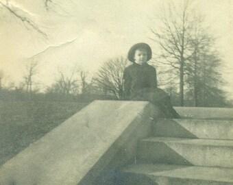 Little Victorian Boy Sitting on Park Steps Winter Coat Hat Antique Black and White Photo Photograph