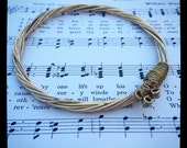Recycled Acoustic Guitar String Bracelet gold colored with brass ball ends attached Unisex trending gift
