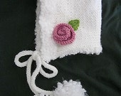 Hand knit white fluffy trim hood style hat with knitted rose