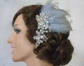 Bridal feather headpiece with a cascade of pearls, cut crystals and crystal rhinestones. Something Blue for your hair, veil, wedding
