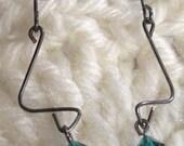 Black metal earring with blue swarovski dangle