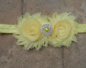 Light yellow shabby flowers with matching pearl rhinestone center on a matching headband newborn-toddler-girls