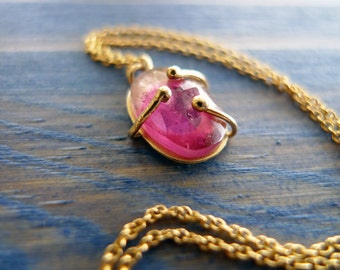 A Small Pink Hug. OOAK Pink Tourmaline Slice Set in Unique 14K Gold Hug. Also Available: Delicate 14K Gold Necklace. Recycled Gold.