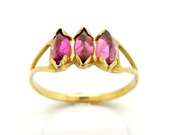 Pink tourmaline engagement ring set in gold