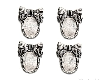 Set of 4.... Antique Silver Base Metal OVAL with Bow....Cameo...Cab...Extra Fancy... Flower....Frame Settings...Oval 20x30mm 19x29mm