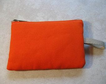 padded zipper pouch in orange duck canvas
