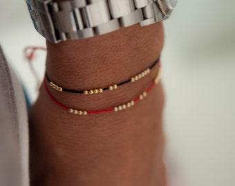 SOLID 14K GOLD delicate  friendship bracelet on black silk cord,  minimalist