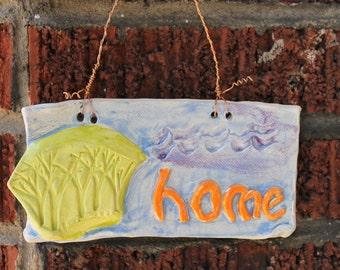 "Colorful ""HOME"" wall tile"