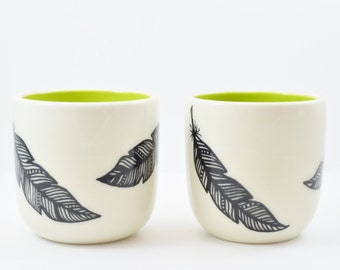 Set of Two Hand Painted Black and White Porcelain Feather Cup with Splash of Chartreuse Inside