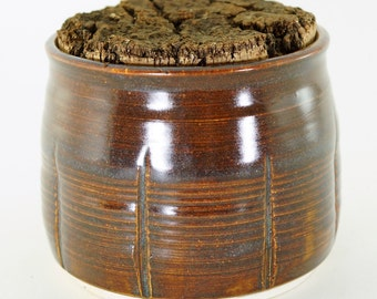 Red brown jar with cork lid