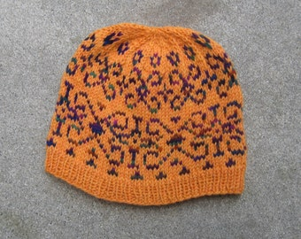 Wool hat: orange with traditional patterns in maroon and green