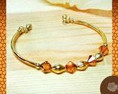 Wrap/Bangle, Swarovski Colorado Topaz Crystal Bicone Memory Bracelet, Gold Spacers and Tubes, and End Dangles