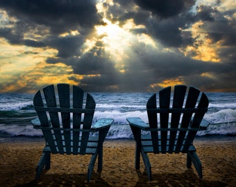 Watching the Sunset of Nature's Splendor with Light Beams bursting through the Clouds on A Lake Michigan Shore A Seascape Nature Photograph