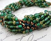 Multi Hued Green Simple Spiral Bracelet