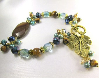 Peacock Freshwater Pearl Bracelet in Aqua, Teal Blue and Gold with Brown Tigers Eye, Czech and Charms