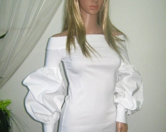Elegant white tunic blouse with long puffed sleeves and bare shoulders