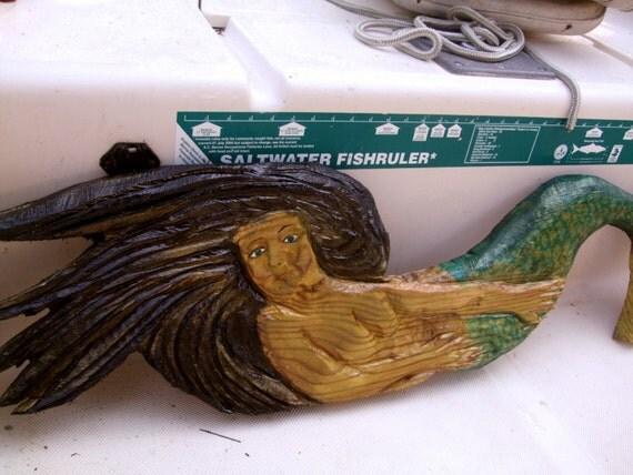 Laying mermaid chain saw carving wood aquatic
