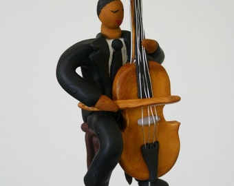 Cellist Ornament CUSTOMIZED to your features Hand Sculpted in Clay