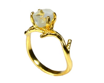Gold plated Bosque ring with green quartz.