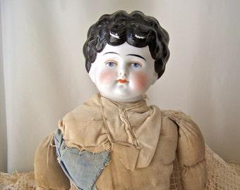 Antique Porcelain Doll Broken - 18.7KB