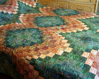 One of a Kind Bargello Queen Size Quilt handmade by Barb Lynn measures 90 by 101 inches and was quilted by Vicki Ibarra at Quilted by Vicki.