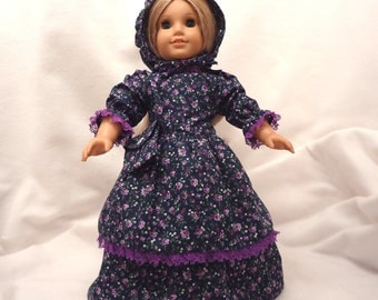 Purple, white, and green floral print on navy blue, long dress for 18 inch dolls, double skirted, with purple lace trim.