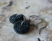 iridescent green disc beaded bead and gunmetal earrings