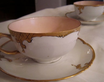Peach Set of Two Cups and Saucers