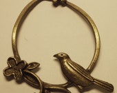 CLEARANCE brass bird in circular branch with flowers charm