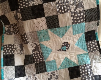 Black, white, and turquoise bird baby quilt