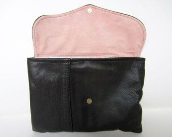 handmade small black leather clutch with flap and pink details