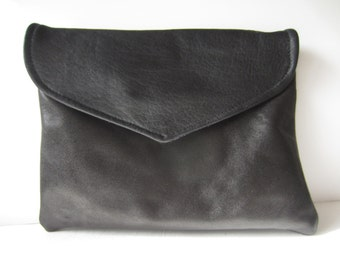 black leather clutch with purple suede under flap