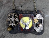 Assemblage rocker chic  necklace with vintage charms