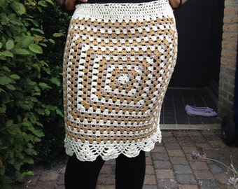 Crochet skirt from 100% very soft bamboo yarn. Creme, gold and taupe mixture yarn. Size small to medium.