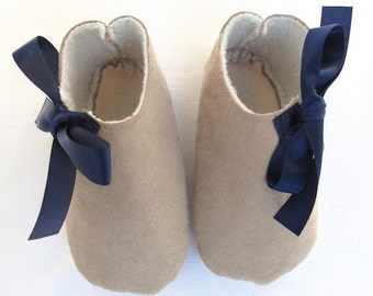 Baby girl shoes, baby booties for winter in brown suede like fabric and fleece lined.