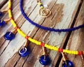 Funky cobalt blue and yellow seed bead necklace w/glass donut dangles