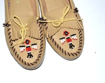 Vintage Minnetonka light brown/ yellow   beaded leather Thunderbird moccasins size 7 Leather Slip on Shoes