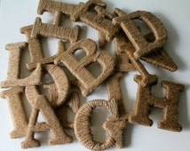 """Multiple 3.5"""" Jute Wrapped Letters."""