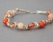 peach bracelet beaded gemstone bracelet in peach and tangerine boho chic leather hemp and sterling silver