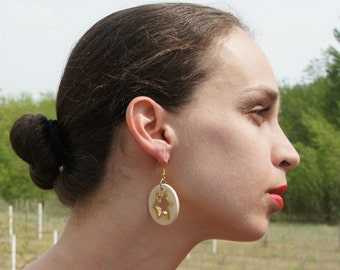 Ceramic earrings with golden star. Ceramic jewelry.