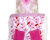Pink Hearts Applique Kitchen Apron with ties and 2 pockets on skirt and Bib is pink & green floral cotton print